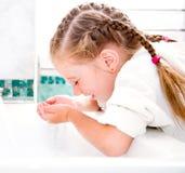 Girl washing in bath Stock Photo