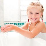 Girl washing in bath Royalty Free Stock Photos