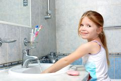Girl washing in bathroom Royalty Free Stock Photography