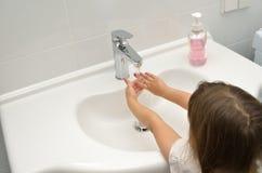 Girl washing in bathroom Stock Photo