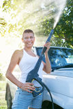 Girl washing car Stock Photography