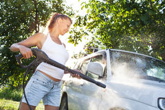 Girl washing car Stock Photo