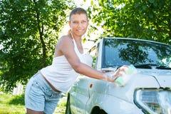 Girl washing car Royalty Free Stock Photo