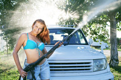 Girl washing car Stock Photography