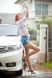 Girl washing a car Royalty Free Stock Image
