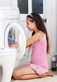 The girl is washing clothes. The beautiful girl is washing clothes in the bathroom Stock Images