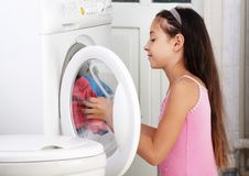The girl is washing clothes. The beautiful girl is washing clothes in the toilet Royalty Free Stock Photo