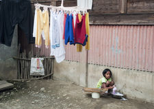 Girl washing clothes Royalty Free Stock Image