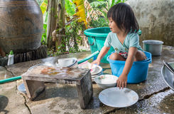 Girl washing dishes Stock Photo