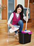 Girl washing  floor with detergent Royalty Free Stock Image