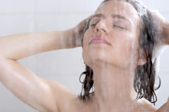 Girl washing head with shampoo Stock Photography
