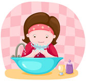 Girl washing her face Royalty Free Stock Images