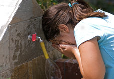 Girl  washing her face Stock Images