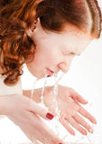 Girl is washing her face Royalty Free Stock Photos
