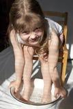 Girl washing her feet stock image
