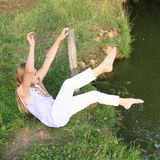 Girl washing her feet by a river Stock Photo