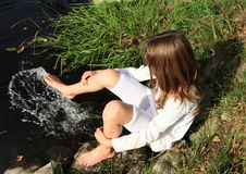 Girl washing her feet Royalty Free Stock Image