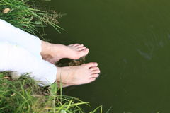 Girl washing her feet Royalty Free Stock Images