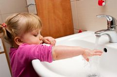 Girl washing her hand Royalty Free Stock Photo
