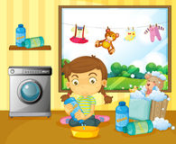 A girl washing her stuffed toys Stock Photos