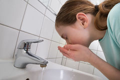Girl Washing Mouth Royalty Free Stock Image