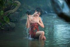 Girl washing in streams. Stock Photos