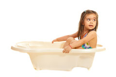 Girl in washtub looking away Royalty Free Stock Image
