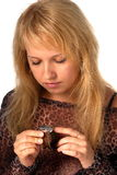 Girl with watch. Beautiful blond looking at watch in heands Royalty Free Stock Photography