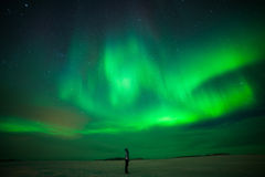 Girl watching Aurora Borealis stock photo