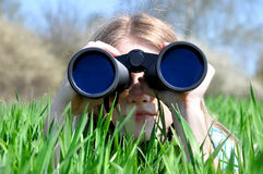Girl watching binoculars Royalty Free Stock Photos