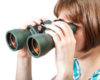 Girl watching through binoculars isolated on white Royalty Free Stock Photos