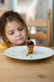 Girl Watching the Cake on White Ceramic Round Plate Royalty Free Stock Image