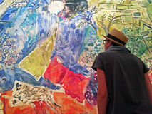 Girl watching a Chagall painting at Cultural Center of Belem Royalty Free Stock Photo