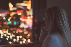 Girl watching city lights Royalty Free Stock Images