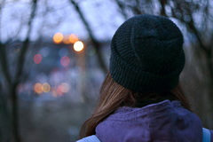 Girl watching at the city lights Stock Photo