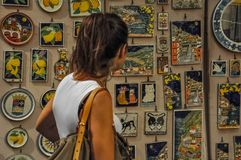 Girl watching a colorful display case of Amalfi stock photography