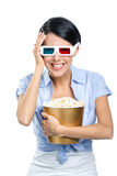 Girl watching 3D film with popcorn Royalty Free Stock Photo