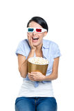 Girl watching 3D movie with bowl of popcorn Stock Photo