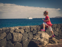Girl watching ferry on the sea Royalty Free Stock Photo