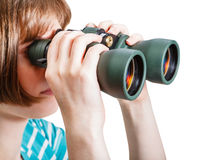 Girl watching through field glasses isolated Royalty Free Stock Photo
