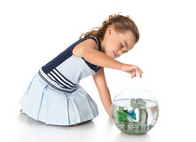 Girl is watching fish in an aquarium Royalty Free Stock Images