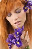 Girl watching flower stock photo