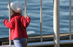 Girl Watching the Horizon. Little girl seems to be looking at the horizon Royalty Free Stock Photo