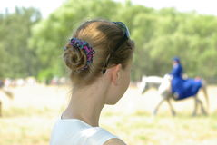 Girl watching a horse Royalty Free Stock Image