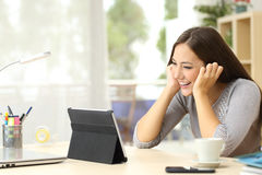 Girl watching media content in a tablet Royalty Free Stock Image