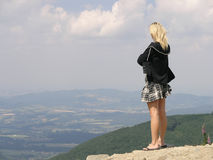 Girl watching mountines Stock Images