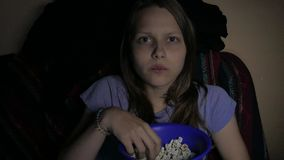 Image result for greedily eating popcorn