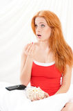 Girl watching movie with popcorn Royalty Free Stock Photography