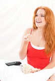 Girl watching movie with popcorn Stock Images