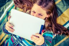 Girl Watching Movie on Tablet Royalty Free Stock Photography